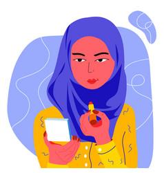 young muslim woman doing makeup vector image