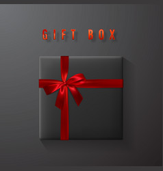 Black gift box with red bow and ribbon top view vector