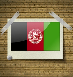 Flags Afghanistan at frame on a brick background vector image
