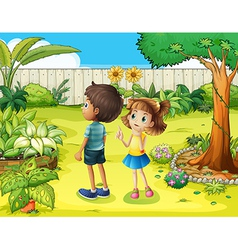 A boy and girl discussing in the garden vector