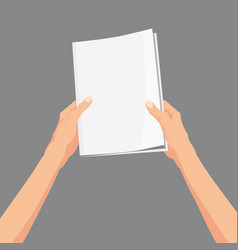 hands holding a magazine brochure book template vector image