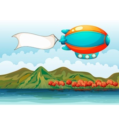 The empty banner carried by the colorful airship vector image