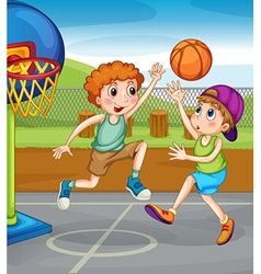 Two boys playing basketball outside vector image