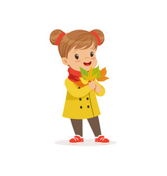 Sweet little girl in warm clothing holding autumn vector