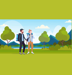 couple tourists hikers with backpacks and stick vector image