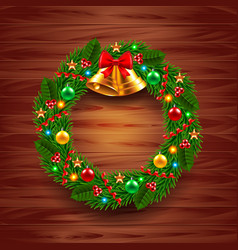 Christmas wreath on wooden background vector