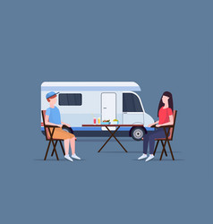 couple sitting at table near camping family vector image