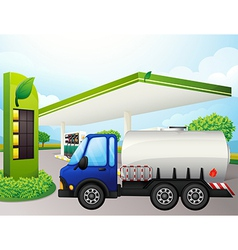 An oil tanker in front a gasoline station vector