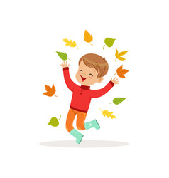 cute little boy in warm clothing jumping and vector image
