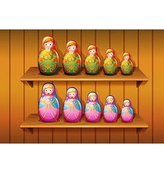 Dolls arranged in the wooden shelves vector image