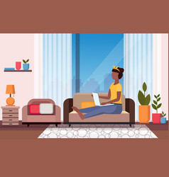 woman sitting on couch using laptop social media vector image