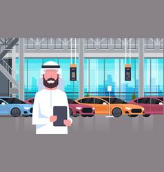 Arab seller man in cars dealership center showroom vector