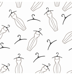 Doodle dresses and hangers seamless pattern vector