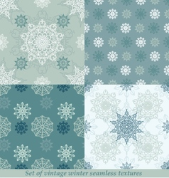 Vintage seamless winter patterns with snowflakes vector