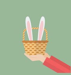 hand holding basket with bunny ears vector image