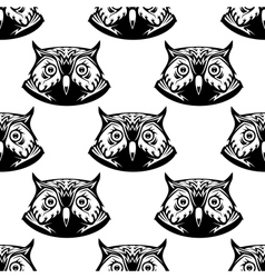 Seamless pattern of wise owl heads vector image