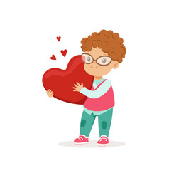 Cute little boy in glasses holding red heart vector
