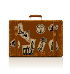 Vintage brown threadbare suitcase with collection vector