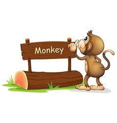 A monkey facing a wooden signboard vector