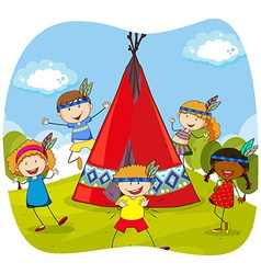 Children playing indians by the teepee vector