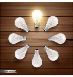 Glowing bulb on wooden background vector image vector image
