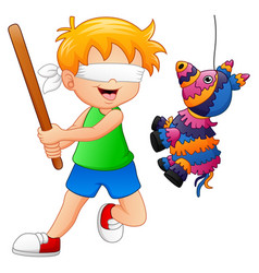 Cartoon boy playing a pinata vector