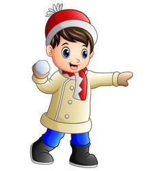 Cartoon boy throwing snowba vector