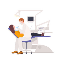 male dentists examining female patient lying in vector image