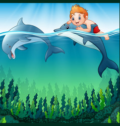 Cartoon boy with dolphins in the sea vector