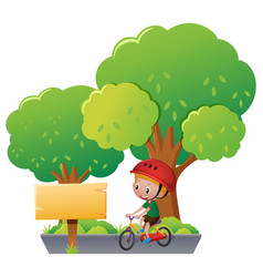 Boy riding bike in the park vector