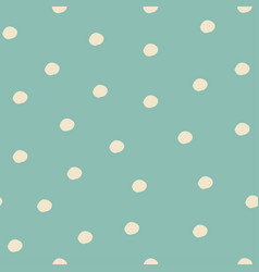 Seamless pattern with falling snowflakes and dots vector