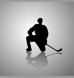 image of a hockey player sitting on one knee with vector image