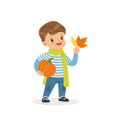 Cute little boy in warm scarf holding pumpkin and vector