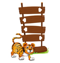 Tiger in front of a wooden signboard vector image