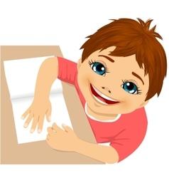 Cute boy doing homework top view vector