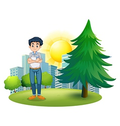 A man standing near the pine tree vector image