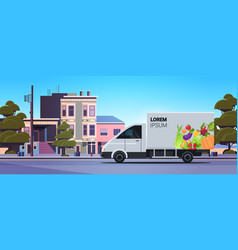 Truck trailer with organic vegetables on city road vector