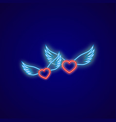 two neon hearts with wings on a blue background vector image vector image
