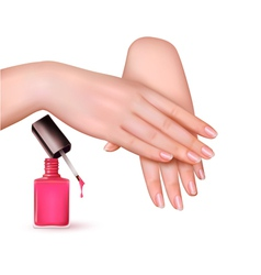 Female young hands with a pink nail polish bottle vector