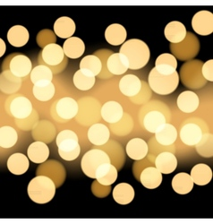 Black background with gold bokeh vector image