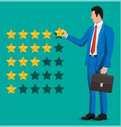 businessman puts rating reviews five stars vector image