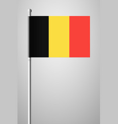 Flag of belgium national flag on flagpole vector