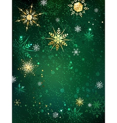 Gold Snowflakes on a Green Background vector