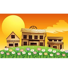 A sunset scene with wooden houses vector image