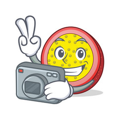 Photographer passion fruit mascot cartoon vector