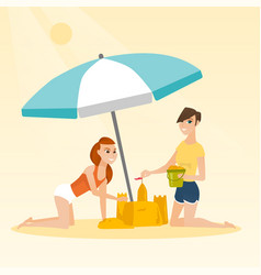 friends building a sandcastle on the beach vector image