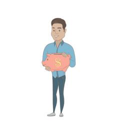 Young hispanic businessman holding a piggy bank vector
