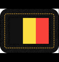 Flag of belgium icon on black leather backdrop vector