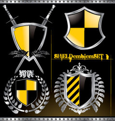 glossy black and yellow shield emblem set vector image