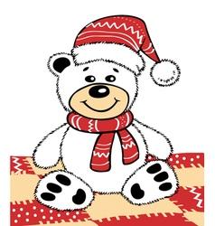 Teddy bear in a Christmas hat vector image